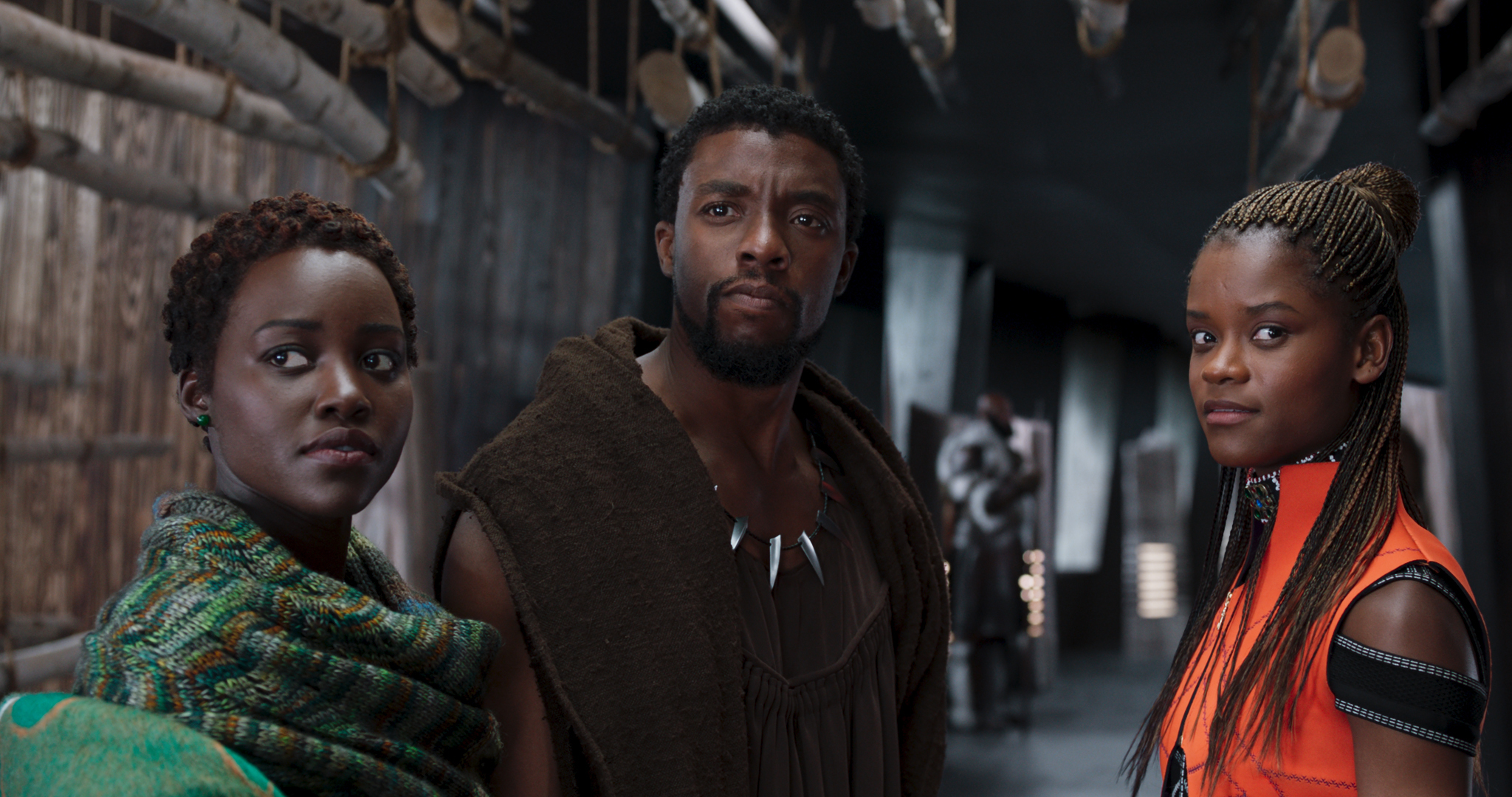 Chadwick Boseman as TChalla, Lupita Nyong'o as Nakia and Letitia Wright as Shuri