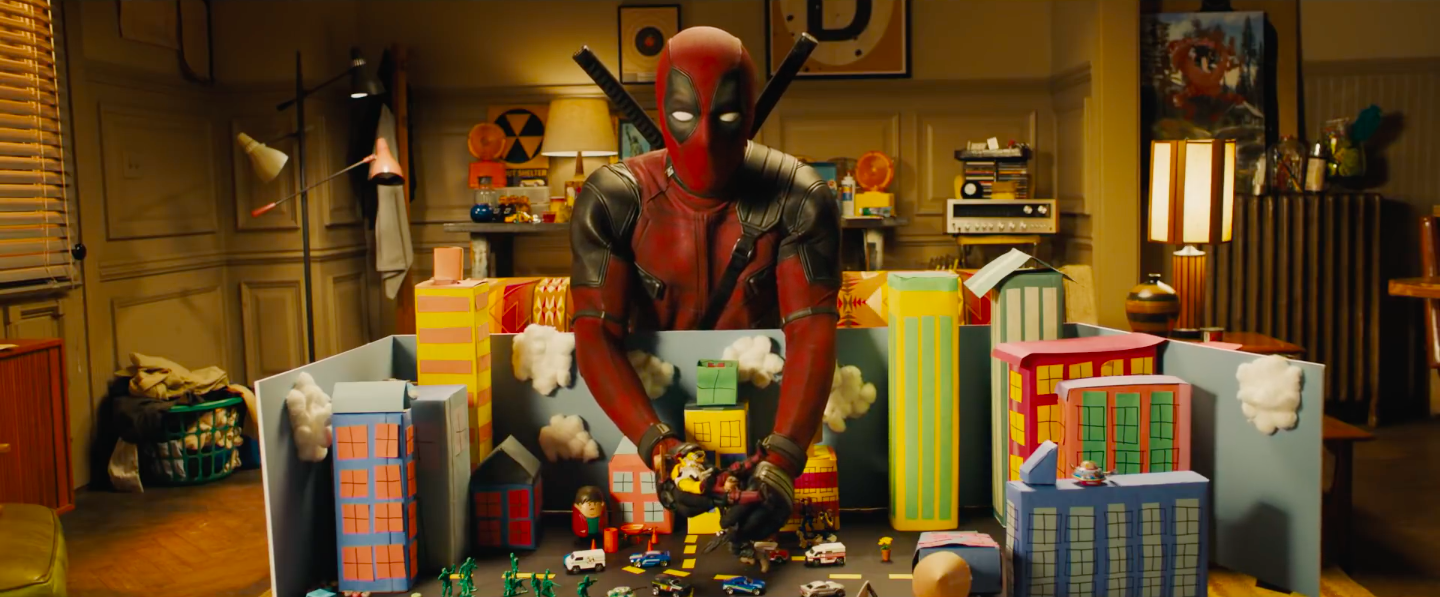 Deadpool playing with his toys like Andy in Toy Story
