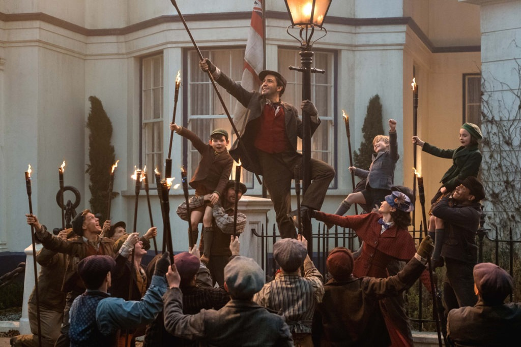 Jack (Lin-Manuel Miranda) Mary Poppins (Emily Blunt) and the Banks children with a crew of street lamplighters