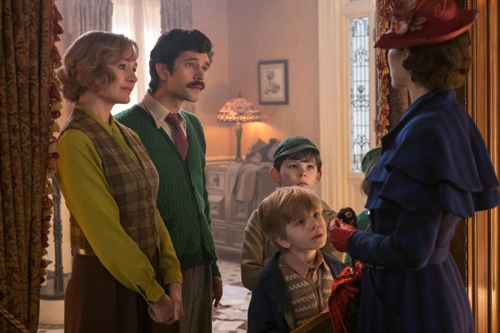 Jane (Emily Mortimer), Michael (Ben Whishaw), John (Nathanael Saleh) and Georgie (Joel Dawson) greet Mary Poppins (Emily Blunt) upon her return to the Banks' home in Disney's original musical MARY POPPINS RETURNS, a sequel to the 1964 MARY POPPINS which takes audiences on an entirely new adventure with the practically perfect nanny and the Banks family.